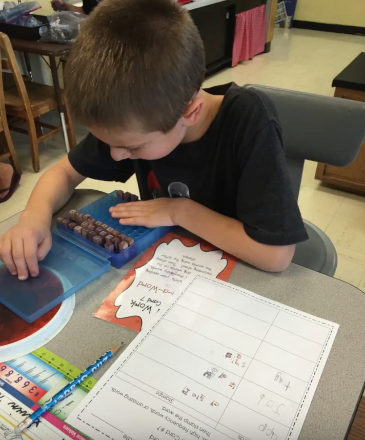 Student doing mini stamper word activity