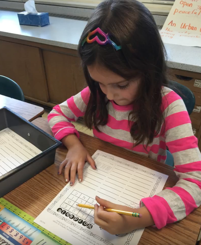 Student using boggle board for word work